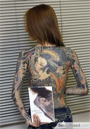 vivid tattoos covering her back